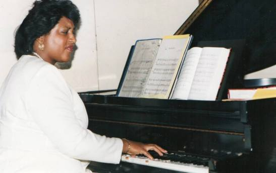 Marjorie playing piani 1980s