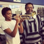 Cass Tech Marching Band student tries out his trumpet. 2017