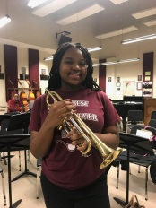 Renaissance H.S. Marching Band students receives her trumpet. 2017